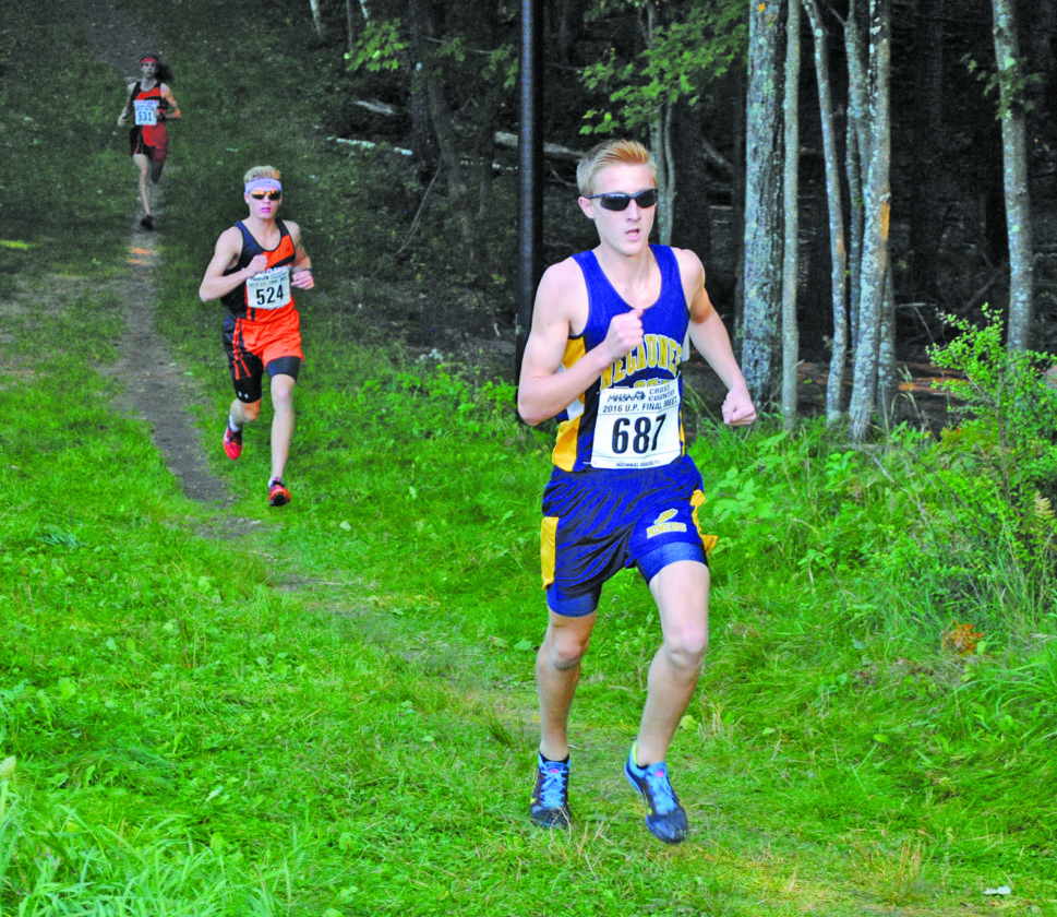 Burt Angeli/The Daily News Photo Negaunee's Colton Yesney finished first and set a course record of 16:24 in Tuesday's invitational.