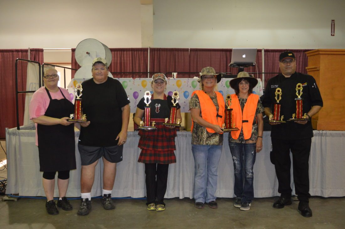 Jordan Beck | Daily Press From left, representatives of Jack's Restaurant, U.P. State Credit Union, Delta County Credit Union, and the Firekeeper's Restaurant celebrate after winning awards at the 23rd annual Soup'r Chili Challenge Tuesday.