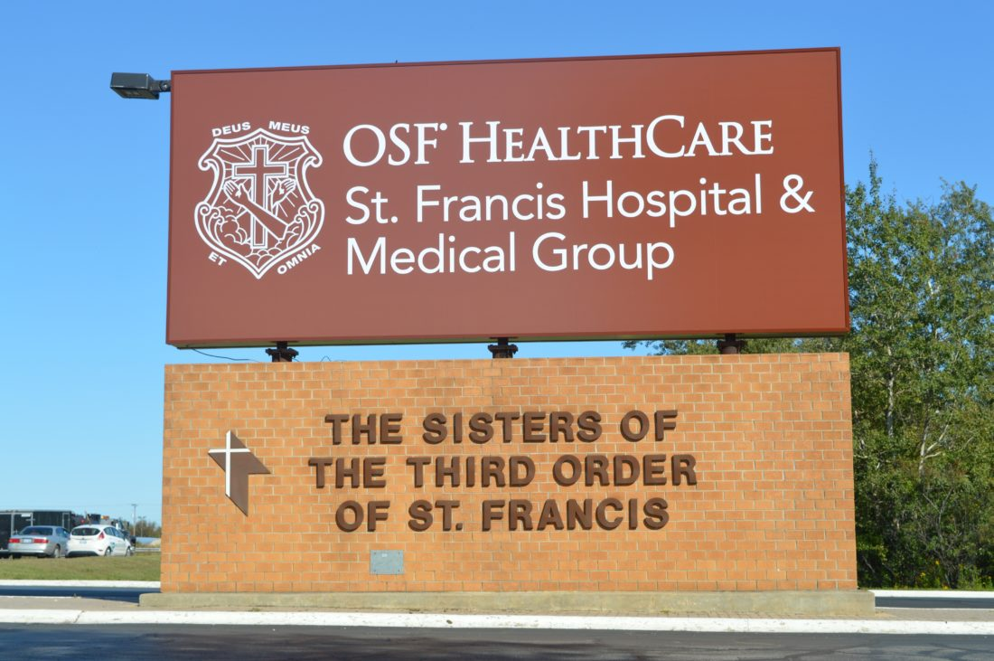Haley Gustafson | Daily Press  The newly updated OSF HealthCare St. Francis Hospital & Medical Group sign is shown at its location on Ludington Street in Escanaba Tuesday.