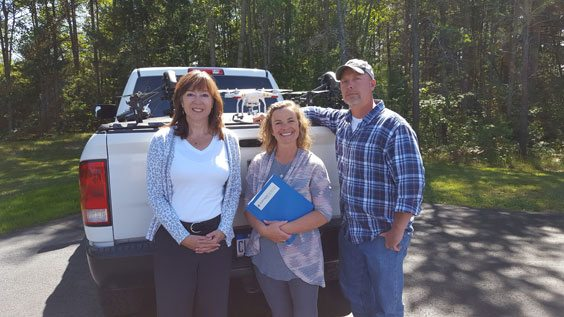 Courtesy photo Northern Initiatives made its 1,000th loan recently. Receiving the loan was Drone Services, LLC, based in Kalkaska, Mich. Shown, from left, are: Northern Initiatives lender Lucy Hoste McCraven and Drone Services LLC owners, Barb and John Hulwick.