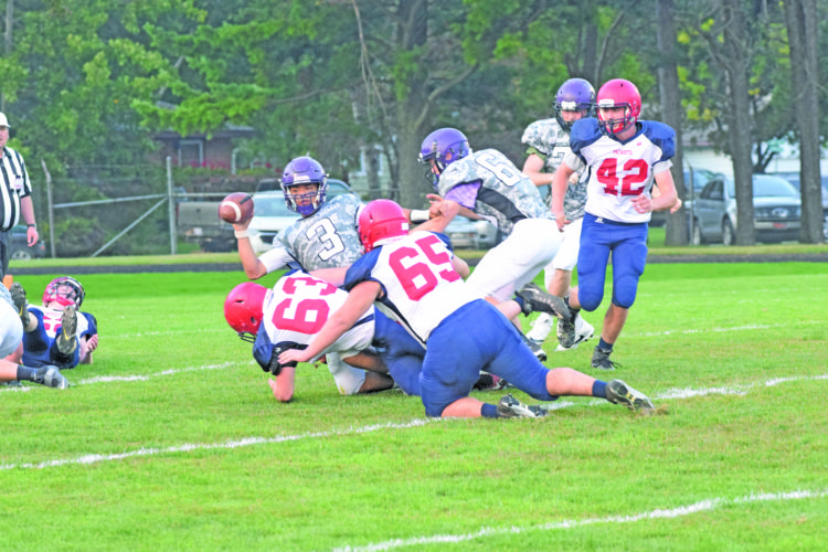 Mike Mattson | Daily Press Gladstone quarterback Darin Johnson (3) gets sacked by Westwood defenders in Friday's game. The Patriots limited Johnson's rushing attack, but he threw two touchdown passes in the Braves 20-12 victory.