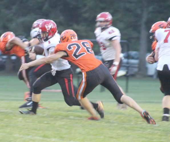 Escanaba's Isaac Cooper tackles Marquette's Brendan Kaski in the second quarter Friday at Escanaba.