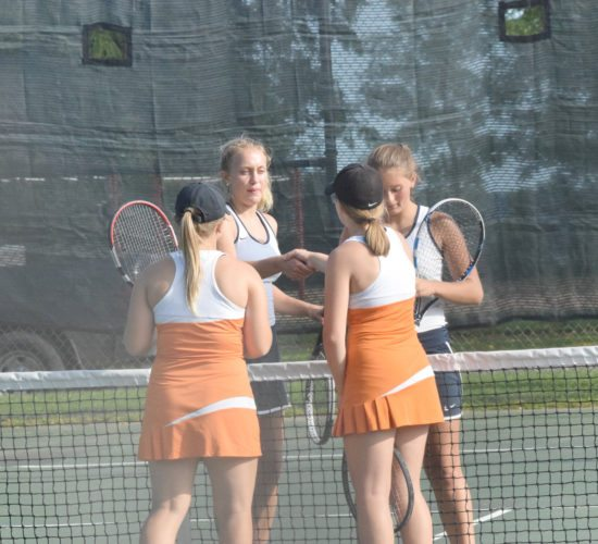 Mike Mattson | Daily Press Negaunee swept Escanaba 8-0 in girls tennis Monday. In front, Esky No. 1 doubles players Heather Bergstrom, left, and Abby Knudsen congratulate Negaunee's Abby Nelson, left, and Mykena Kontio after the Miners' duo earned a 6-4, 6-2 victory.
