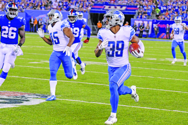 AP photo Detroit's Jamal Agnew returns a punt for a touchdown during the second half against the New York Giants Monday night. Agnew's return broke open the game for the Lions.