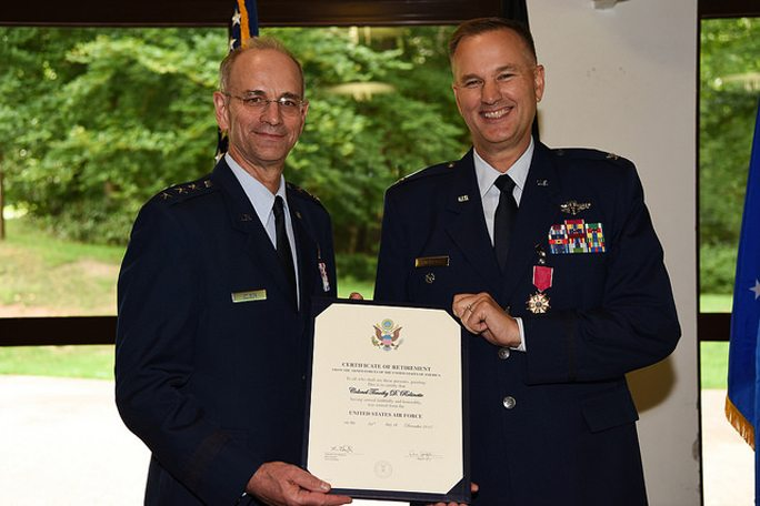 Courtesy photo Lt. Gen. Mark A. Ediger, Surgeon General of the Air Force, and Col. Timothy Robinette pose for a photo with Robinette's certificate of retirement, Aug. 24, 2017, at Ramstein Air Base, Germany.