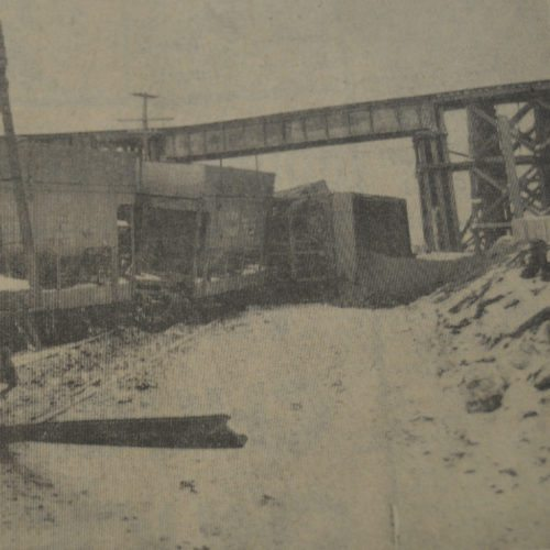 Daily Press photos The Chicago Northwestern Railway suffered a derailment of units in this 1958 Daily Press photos. The units spilled out palletized ore from the 11 cars that tipped over.