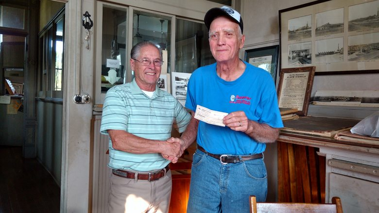 Courtesy photo The IXL Historical Museum in Hermansville recently received a donation of $300 from the Hermansville Car Club. Shown in the photo is board member Eugene Arduin accepting the check from Hermansville Car Club's president Floyd Provo. The Hermansville Car Club hosts an annual classic car show on the museum grounds as part of Hermansville's Independence Day Celebration.