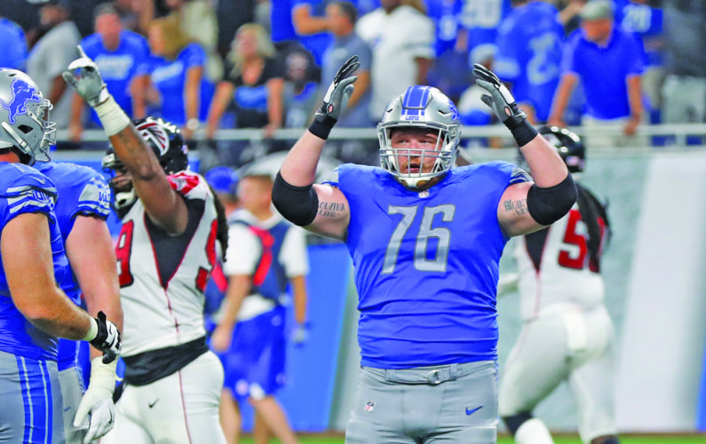 AP photo Detroit Lions offensive guard T.J. Lang (76) reacts as the Atlanta Falcons win the game  Sunday after a review of the final play.