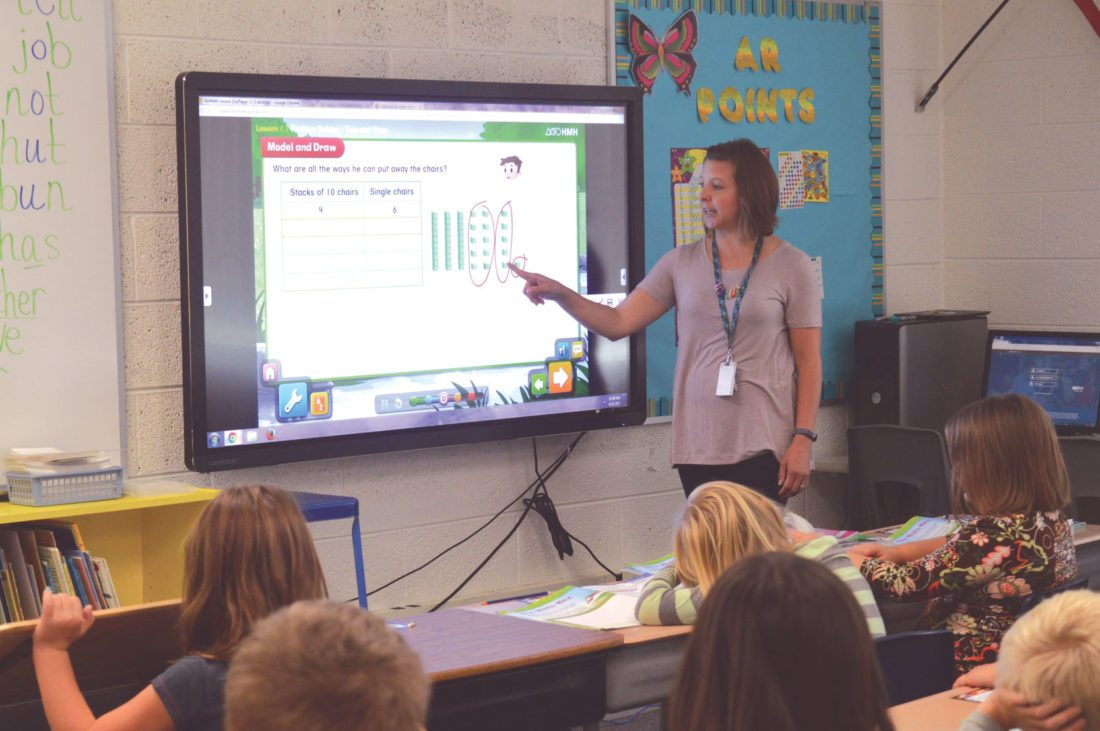Haley Gustafson | Daily Press  Bark River Harris Elementary School second grade teacher Kristy Erickson uses the school's new Clevertouch board to explain a math problem last week. The boards, which are replacing the school's Smartboards, will be implemented in all classrooms throughout the entire Bark River School District over the next three years.