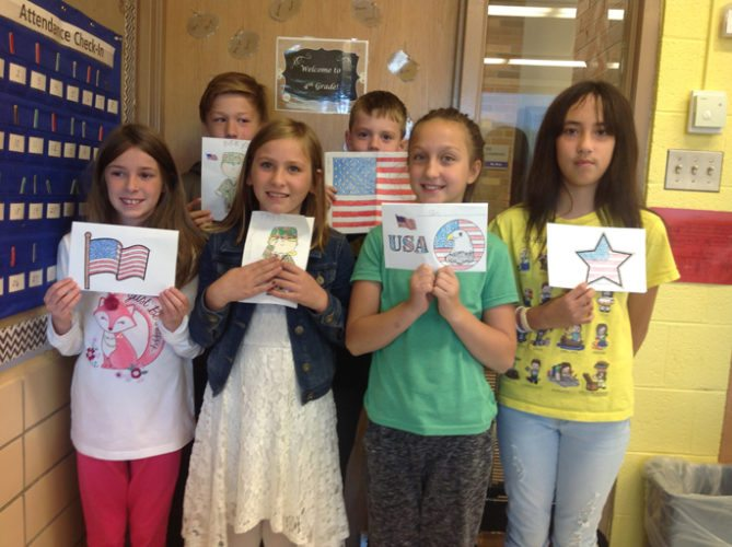 Courtesy photo Students in Mrs. Chouinard's art classes at James T. Jones Elementary School made thank you cards for the veterans going on the Honor Flight today. Students were introduced to the history of the Honor Flight, a virtual tour of the WWII Memorial and art that was created during that time period. Pictured in back, from left, Evan Johnson, and Wyatt Jorgensen; in front, from left, Lily Clausen, Natalie Cartwright, Elin Culbertson, and Ashley Hebert.