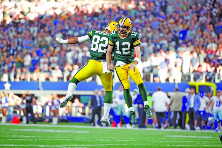 AP photo Green Bay's Richard Rodgers (82) and Aaron Rodgers (12) celebrate a touchdown late in the second half against the Dallas.