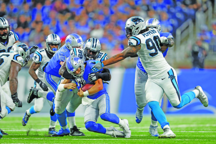 AP photo Detroit Lions quarterback Matthew Stafford (9) is sacked by Carolina Panthers defensive tackle Kawann Short (99) during the second half Sunday. Stafford was sacked six times in the loss to the Panthers.