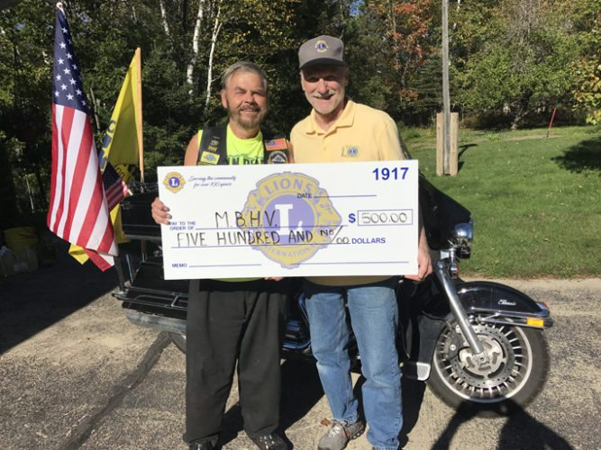 Courtesy photo The Days River River/Brampton Area Lions Club recently made a donation to the Michigan Bikers Helping Veterans (MBHV) in the amount of $500 for their assistance in putting on a fish fry dinner to help area residents and veterans. Shown in the photo is Lion Jeff Ware presenting the check to MBHV member Al Salmi.