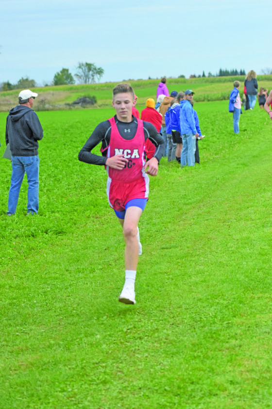 North Central's Griffin Johnson, shown racing in last Thursday's Gladstone Invitational, finished runner-up Wednesday in the Skyline Central Conference boys' race in Munising.