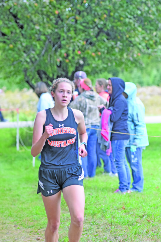 Munising's Madeleine Peramaki, shown in the Gladstone Invitational, finished first Wednesday in the Skyline Central girls' race.