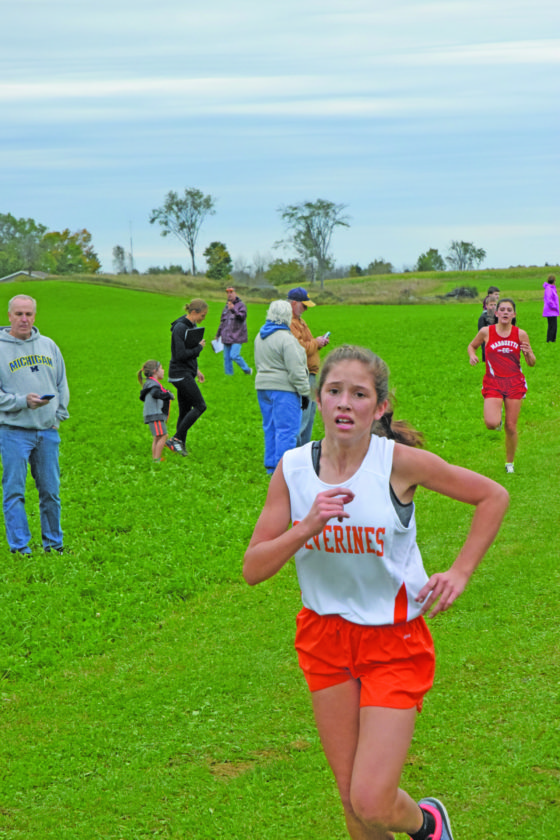 Mid Peninsula's Daisy Englund, shown running in last Thursday's Gladstone Invitational, finished fourth in Wednesday's Skyline Central Conference girls' race.