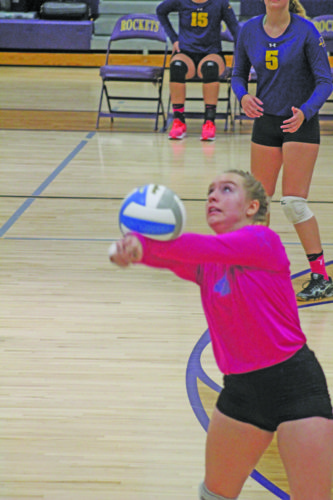 Avery Bundgaard | Daily Press Rapid River's Cassidy Berg hits the ball during the third set against Forest Park Thursday at Rapid River.