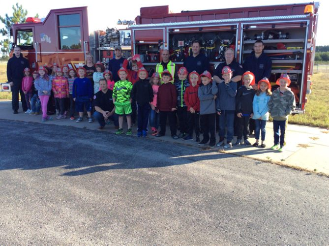 "Courtesy photo  Kim Viau's second grade class at Rapid River Elementary School pose for a photo with Ensign and Masonville Township Volunteer Fire Department firefighters. During the firefighters' visit to the school, students learned how to ""stop, drop, and roll"" from firehouse dog, ""Sparky."" The students also were visited by the Valley Med Flight, and had the chance to experience the fire department's smokehouse. Shown are firefighter Zack Christianson, second graders Makayla Williams, Adrian Brase, Khloe Medwayosh, Audi Moulds, Kaylee Scott, Natalie Paquette, Victoria Coppock, Olivia Quinn, Bobby Micheau, Mrs. Kim Viau, Madison Harris, firefighter Paul Ammel, Skylar Ammel, Brian VanOss, Nicklas Proehl, Beau Nedeau, Brady Schram, Ashlynn Thompson, firefighter Craig Lancour, Cole Constantino, Jaeger Wils, firefighter Leo Vietzke, Brennen Kee, Kamden Chmurynski, firefighter Jim Lundberg, Logan Lawson, firefighter Devin Werner, Hayden Kee, Meghan Proehl, and Abe Junttila."