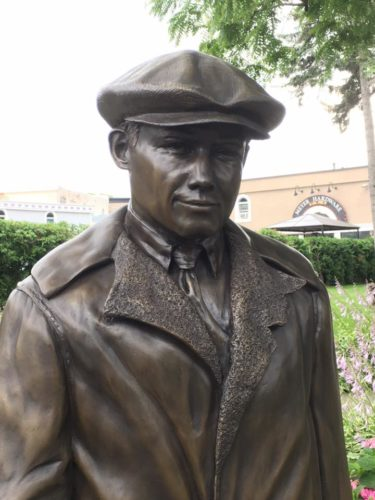 Courtesy photo This sculpture of Hemingway as a young man, created by Gladstone artist Andy Sacksteder, was unveiled at Pennsylvania Park in downtown Petoskey this summer. A 1920 photograph of Hemingway, taken in Petoskey, guided Sacksteder's creation