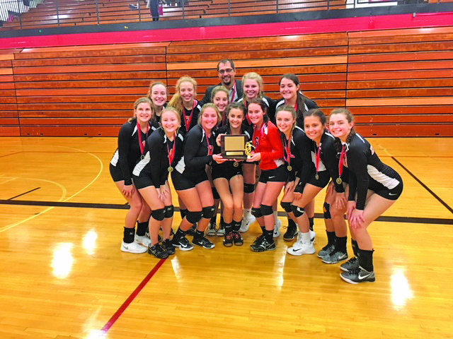 Courtesy photo The Escanaba volleyball team captured Saturday's Great Northern Conference volleyball tournament  title and shared the overall league championship with Sault Ste. Marie. Team members front row from left are: Jalin Olsen, Haillie McDonough, Katie Wilson, Peyton Gustafson, Kaitlyn Lord, Dacota Lambert and Gabi Stalboerger. Back row from left are: Lexi Chaillier, Taleise Lawrence, Kaleia Lawrence, Savanna Barron, Coach Adam Lambert, Paxton Johnson and Paige Wendt.