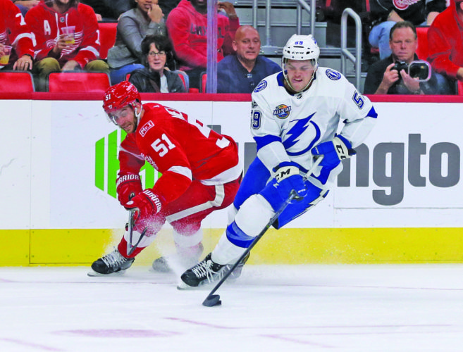 AP photo Tampa Bay Lightning defenseman Jake Dotchin (59) steals the puck from Detroit Red Wings center Frans Nielsen (51) during the second period Monday.