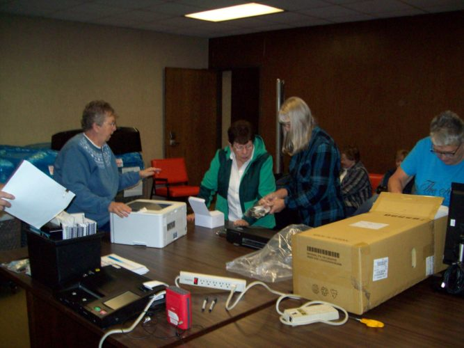 Liz Hill | Daily Press Unpacking the new voting machine are (left to right) Peggy Ruggles, Sandy LaBar, Cindy Jenerou and Kay Hinkson.