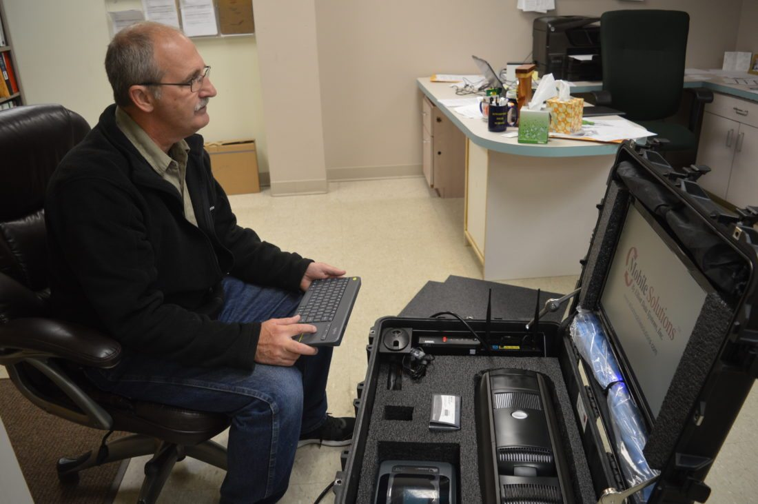 Jordan Beck | Daily Press Delta County Emergency Management Coordinator Bob Berbohm tests out a new mobile emergency response tracking system. The system was paid for with Tier III funding from the U.S. Forest Service.