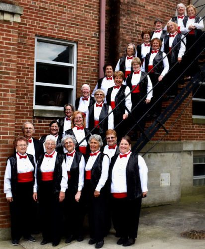 "Courtesy photo The Menominee River Chorus will perform its 17th annual show, ""Terminal Jet Lag,"" starting at 7 p.m. Saturday at the Blesch Auditorium in Menominee. Members of the Menominee River Chorus include, first row: Joan Bantle, Cathy Kordish, Mickey Marcusen, Marja Spataro, Jilll Leslie and Tara Segerstrom; first row up stairs: Linda Sieman, Mary Omdahl, Sandy Rhode, Gail Sieglaff, Jean Clement, Sherri Garrnett and Karla Vollberg; and back row up stairs: Director Ed Boehm, Susan Thornton, Pat Troutt, Edwina Wandersee, Ellie O'Donnell, Betty Nyberg, Carol Lehto, Patti Ugowski and Sue Hubbard."