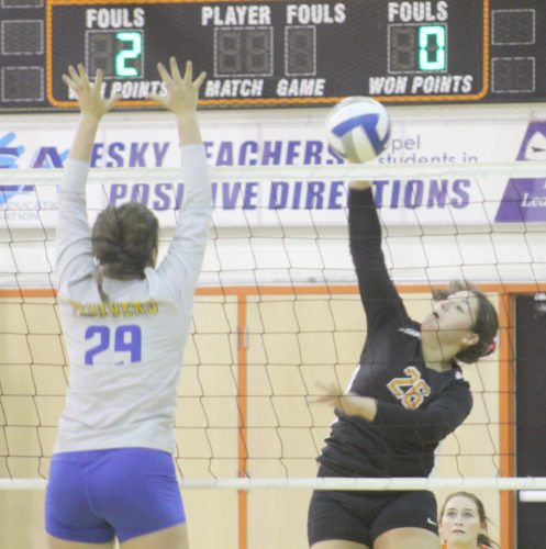 Avery Bundgaard | Daily Press Escanaba's Paige Wendt (26) spikes the ball over the net as Kingsford's Aby Pickett attempts a block during the third set Tuesday at Escanaba.