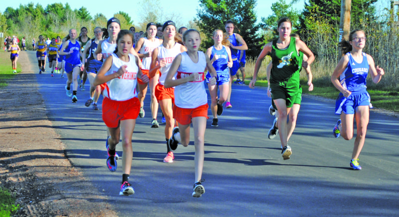 Burt Angeli/The Daily News Photo Mid Peninsula's Landry Koski (second from left) ran from the front in winning the Norway Invitational girls cross country meet Tuesday at Strawberry Lake Park. Superior Central's Danika Walters (far right) was runner-up.