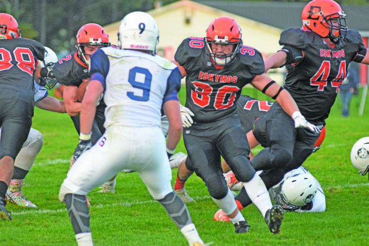 Mike Mattson | Daily Press Scout Wunder (2), far left, heads up field as teammates Logan Carroll (30) and Cody Vandermissen (44) clear some running room against Kyle Huskey (9) and the Sault defense earlier this season. Escanaba hopes to keep its ground game clicking at Kingsford.