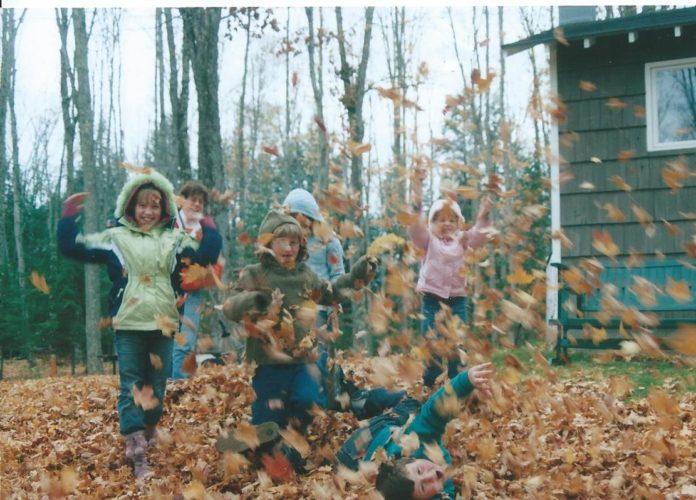 "Courtesy photo Britt, Sherri, Ellen, Kelsey, Patti, and Bob having fun with ""leaf rain."""