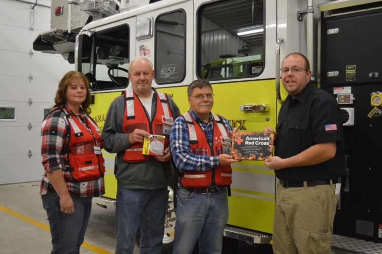 Haley Gustafson | Daily Press  The Escanaba Township Volunteer Fire Department received an appreciation plaque from the American Red Cross last week for helping install 260 smoke detectors in local resident's homes. The project to install the over $5,000 worth of smoke detectors was in conjunction with National FIre Prevention Month held throughout October. Shown from left are American Red Cross Disaster Team Members Marie DeHaan, Don Kopacz, Gary Casey and Escanaba Township Volunteer Fire Department Chief Matt Rian.