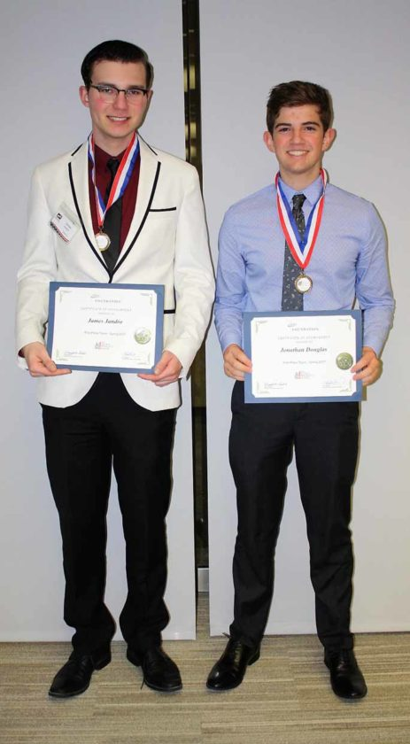 Courtesy photo Two students in Erika Fix's class at Gladstone HIgh School, James Jandro, left, and Jonathan Douglas, won the statewide stock market game competition for the spring 2017 semester.  They were honored at a champions banquet at the Federal Reserve of Chicago Detroit Branch in May.