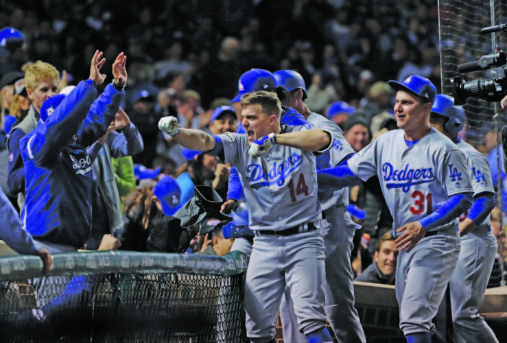 AP photo The Dodgers' Enrique Hernandez (14) celebrates after hitting a grand slam during the third inning of Game 5 Thursday against the Chicago Cubs.