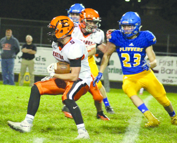 Theresa Proudfit/The Daily News Escanaba's Joshua Grassel (5) looks for running room while Kingsford's Andrew Kleikamp (23) closes in Friday.