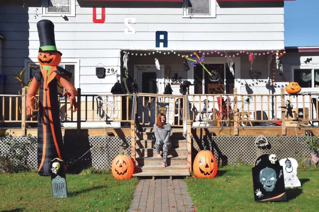 Jordan Beck | Daily Press Escanaba resident Autumn Stemick is pictured amongst some of her family's Halloween decorations. Stemick said her family started decorating their home for Halloween three or four years ago.