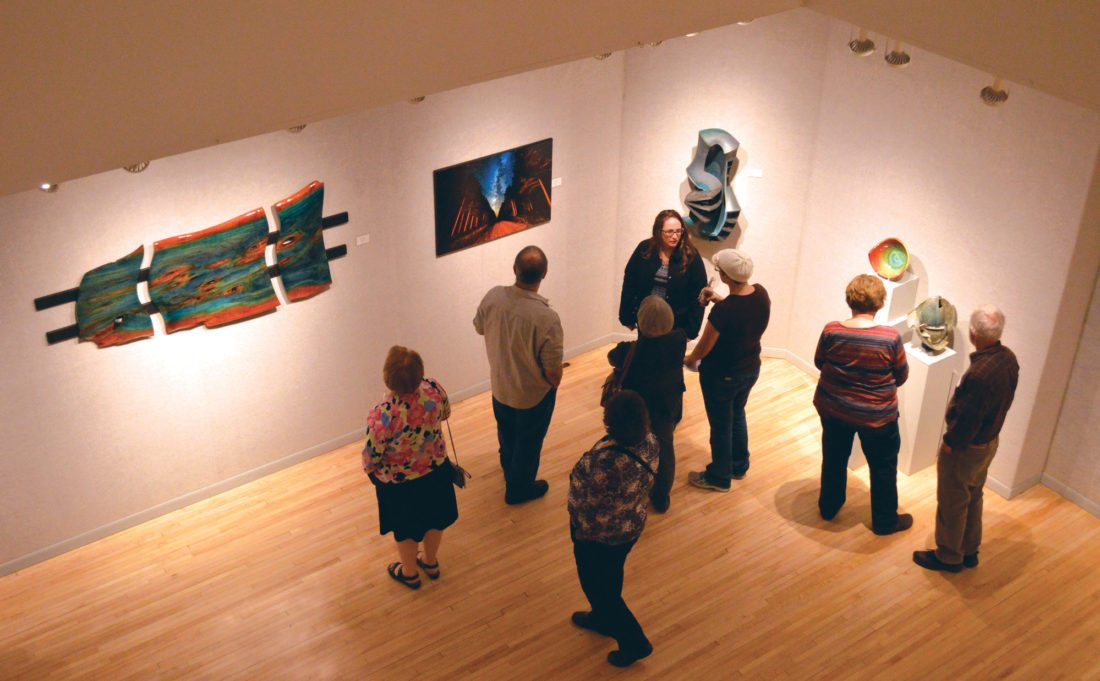 Ilsa Matthes | Daily Press Guest view art at last year's Northern Exposure reception.