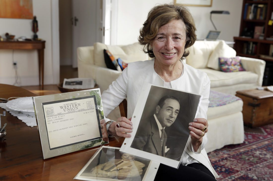 Lauren Friedman, daughter of lawyer Samuel Friedman, poses with photos of her father, and a telegram from Thurgood Marshall, in her New York apartment, Monday, Oct. 23, 2017. A new movie about Thurgood Marshall focuses on a rape case he worked on, well before he won a landmark school desegregation case and a quarter-century before he became a Supreme Court justice. In early 1941, Marshall was in Bridgeport, Conn., to represent Joseph Spell, a black chauffeur accused by his wealthy, white employer of rape. Because Marshall was an out-of-state attorney, he enlisted the help of a local lawyer, Sam Friedman, who was white and had expertise in trying civil cases, not criminal ones. (AP Photo/Richard Drew)
