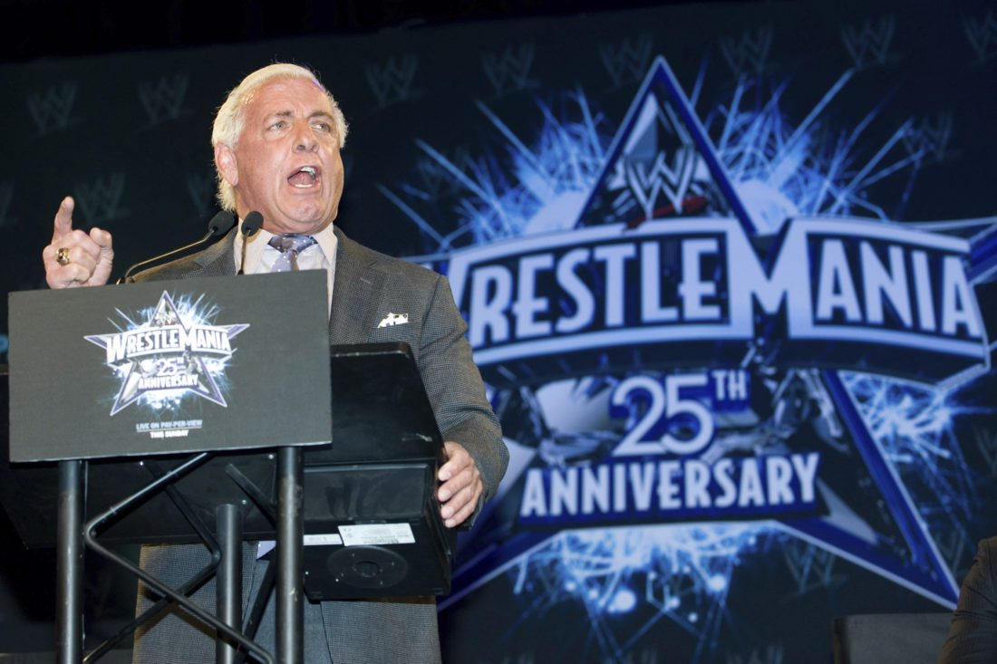 """FILE - In this March 31, 2009, file photo, wrestler Ric Flair attends the 25th Anniversary of WrestleMania press conference at the Hard Rock Cafe in New York. Flair, whose """"Wooooooo!"""" call during promos and matches became one of the most imitated catchphrases in sports, thought he would die. Alive, and with a new lease on life, Flair tells The Associated Press he's done drinking and vows to clean up his act with whatever time he has left. (AP Photo/Charles Sykes, File)"""