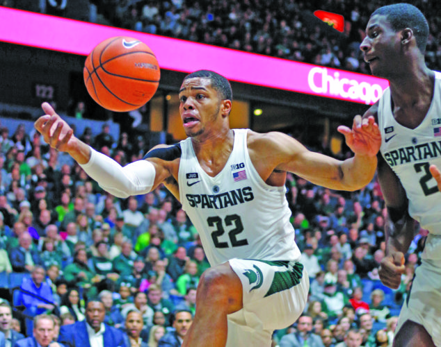 AP photo Michigan State's Miles Bridges (22) pulls in a loose ball during the first half of a recent exhibition game against Georgia in Grand Rapids. Bridges was selected to The Associated Press preseason All-America team on Monday.