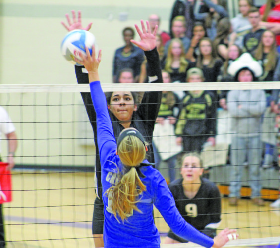 Avery Bundgaard | Daily Press Calumet's Celia Kiilunen (front) hits the ball over the net as LaSalle's Keshia Davis (back) attempts the block Tuesday during a Class C regional semifinal at Gladstone.