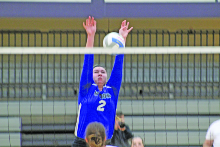 Avery Bundgaard | Daily Press West Iron County's Rachael Tefft blocks the ball at the net against Westwood Tuesday during a Class C regional semifinal at Gladstone.