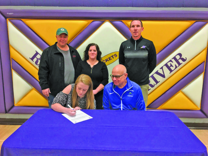Courtesy photo Rapid River's Elizabeth Goodacre signed a national letter of intent Tuesday to attend Bay College and play basketball for the Norse. She is the first signee in Coach Rae Drake Jr.'s 2018-19 recruiting class. Goodacre and Drake Jr. are pictured in the front row. In the back row from left are: Parents Scott and Julie Goodacre and Athletic Director Rick Pepin.