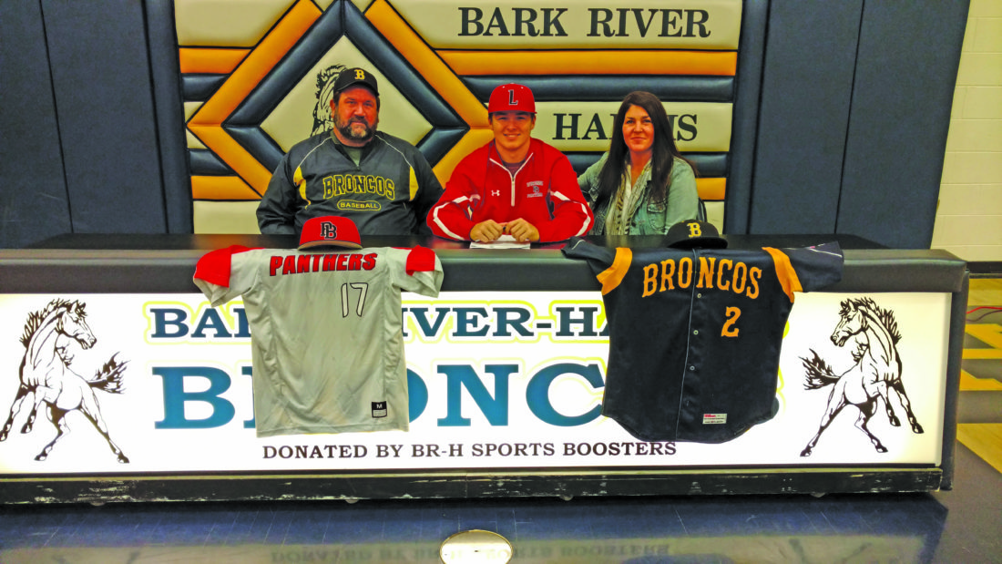 Courtesy photo Bark River-Harris senior Logan Heim recently signed a national letter-of-intent to attend and play baseball at Lake Land College in Mattoon, Ill. Lake Land, located in Southeastern Illinois, competes in Region 24 of the National Junior College Athletic Association. Heim played catcher and shortstop for the Broncos last season under coach Al Botwright. Pictured with Logan Heim for the signing were his parents, Mark Heim and Lynn Dupey.