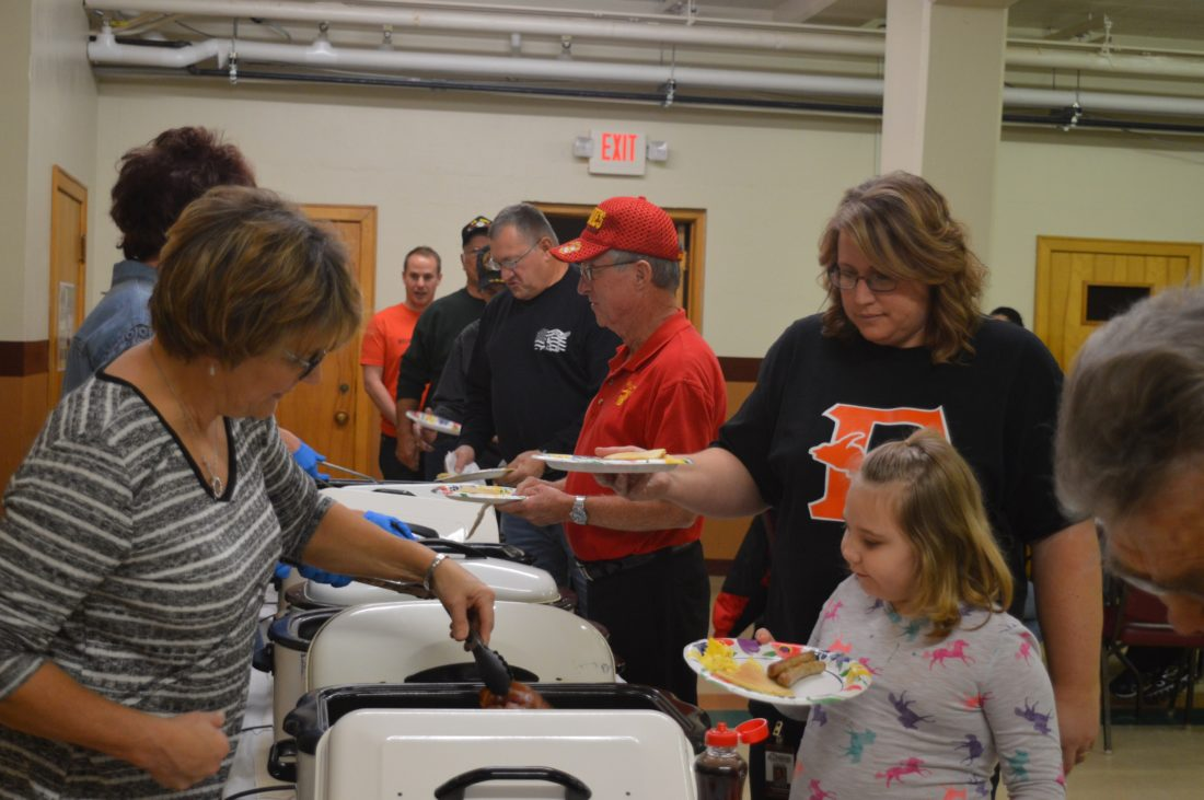 Haley Gustafson | Daily Press Delta Schoolcraft Intermediate School District (DSISD) Learning Center staff serve up breakfast to area veterans and Learning Center students Friday during the school's Veterans Day breakfast.