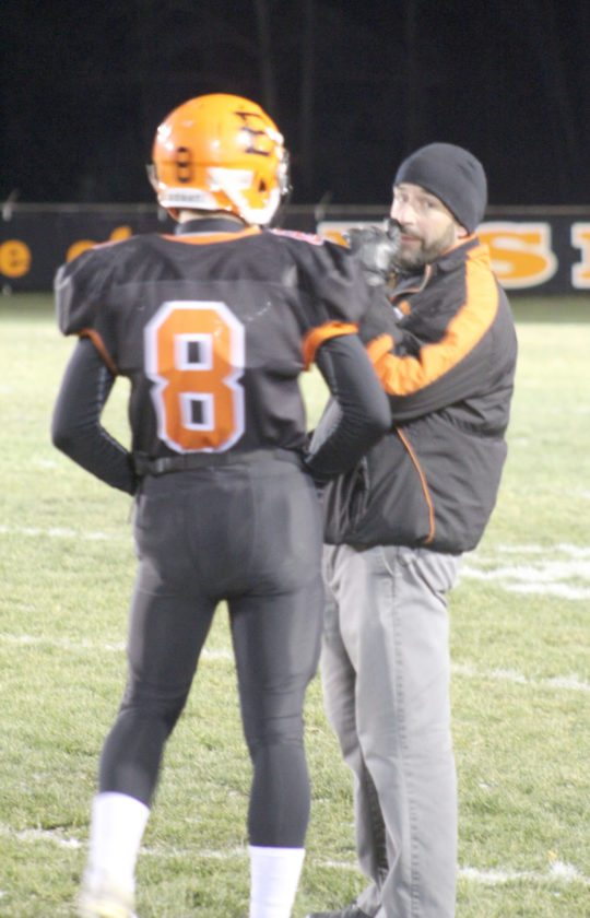 Avery Bundgaard | Daily Press Escanaba coach Dave Howes (right) talks with his quarterback Craig Kamin before a play during the Division 4 regional final against Williamston Friday at Escanaba.