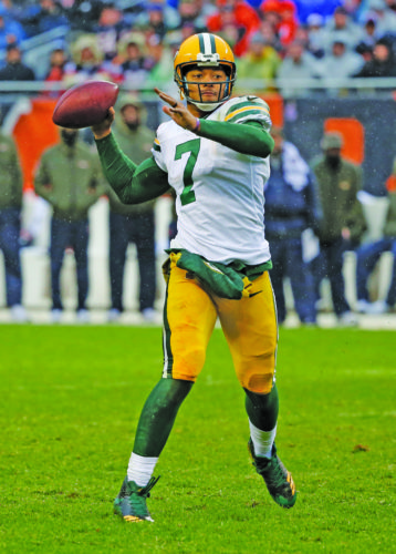 Green Bay Packers quarterback Brett Hundley (7) throws a touchdown pass to wide receiver Davante Adams during the second half of an NFL football game against the Chicago Bears, Sunday, Nov. 12, 2017, in Chicago. (AP Photo/Charles Rex Arbogast)