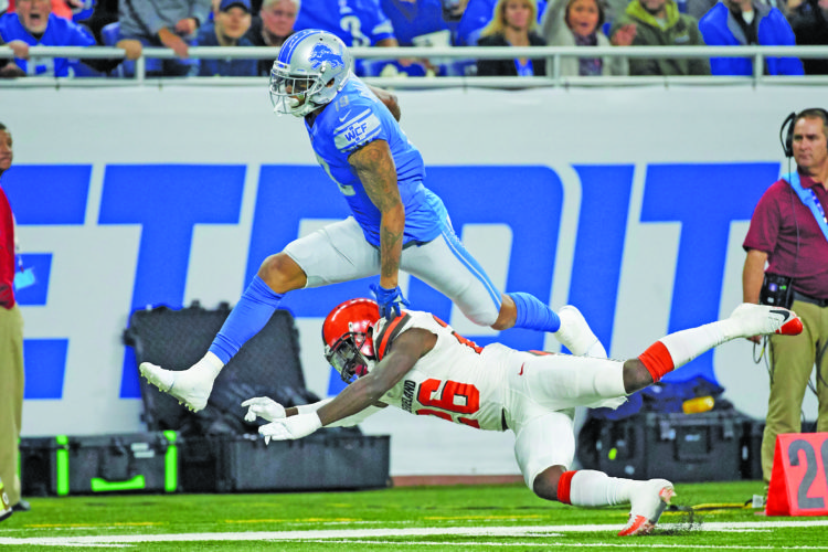 Detroit Lions wide receiver Kenny Golladay (19) leaps over Cleveland Browns strong safety Derrick Kindred (26) during an NFL football game, Sunday, Nov. 12, 2017, in Detroit. (AP Photo/Rick Osentoski)