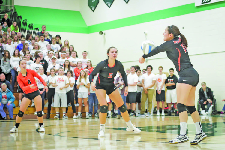 Sault News photo by Isiah Otten Keira Stampfly, right, catches the ball squarely for a bump in Munising's Class D quarterfinal volleyball match against Rudyard in Manistique on Tuesday. Watching the play is teammate Kianne Wendt.